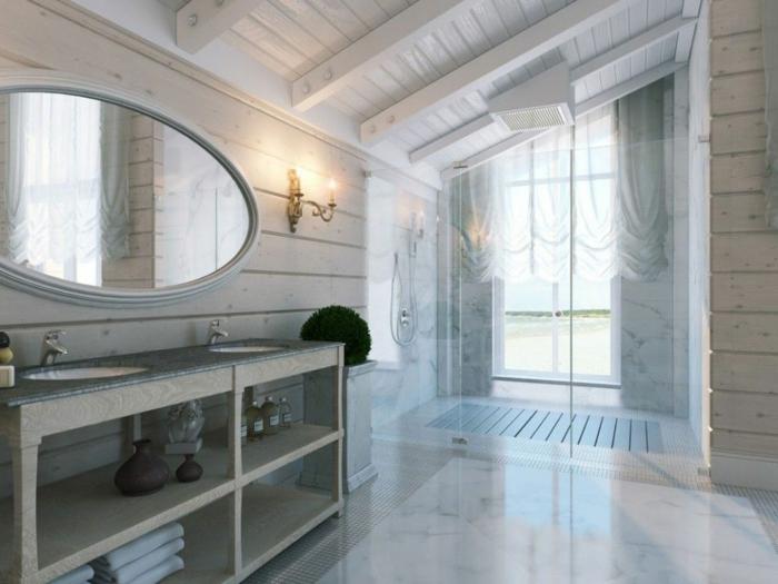 jolie salle d'eau avec lambris mural clair, meuble vasque avec rangement, cabine de douche sous pente