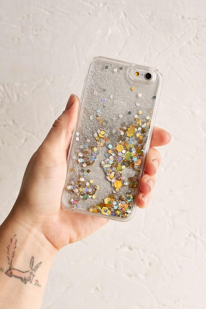modèle de coque en silicone transparente décorée avec glitter argenté et strass doré pour un portable style féminin
