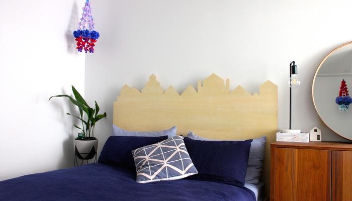 une silhouette de ville découpée dans une tete de lit bois en panneau de contreplaqué pour personnaliser sa déco de chambre à coucher