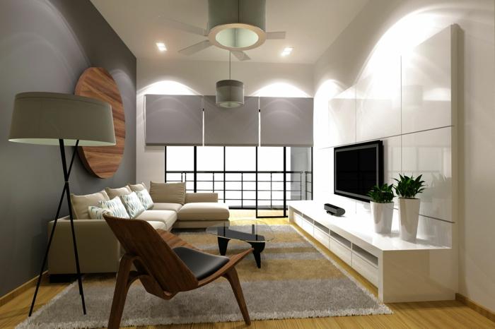feng shui salon, deco salon zen, tapis en gris et marron, meuble blanc avec surface brillante, luminaire avec abat-jour gris, mur gris et stores gris, portes balcon coulissantes en métal noir et verre
