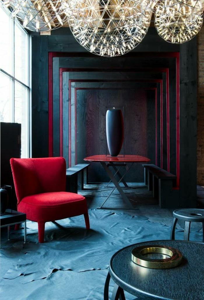 fauteuil rouge, plafonniers modernes, table pliante rouge, tapis bleus, couleur de peinture originale
