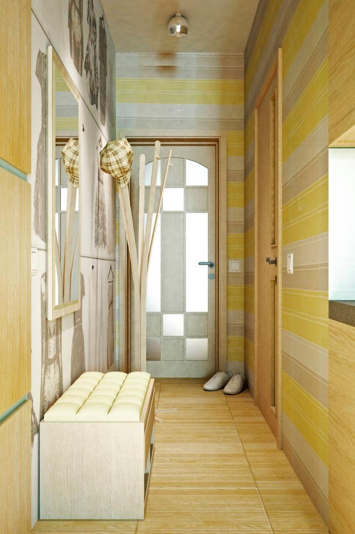 design intérieur en couleurs vert et jaune avec papier peint rayé et plancher à imitation bois clair, meubles de couloir banc bois et miroir