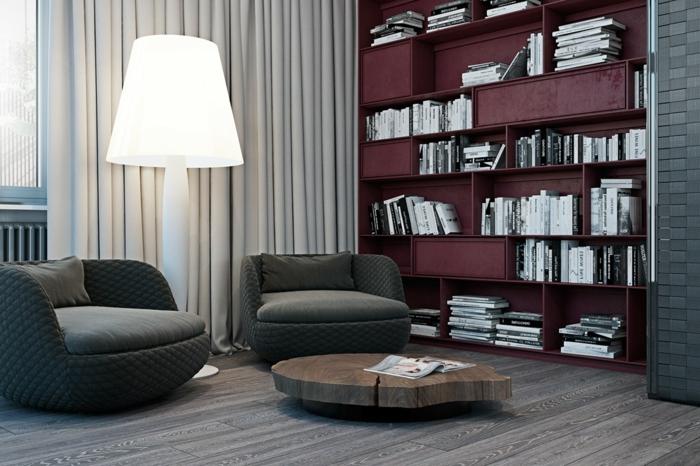 séjour en gris et rouge, table basse en bois, fauteuils ronds couleur grise, grande lame de sol