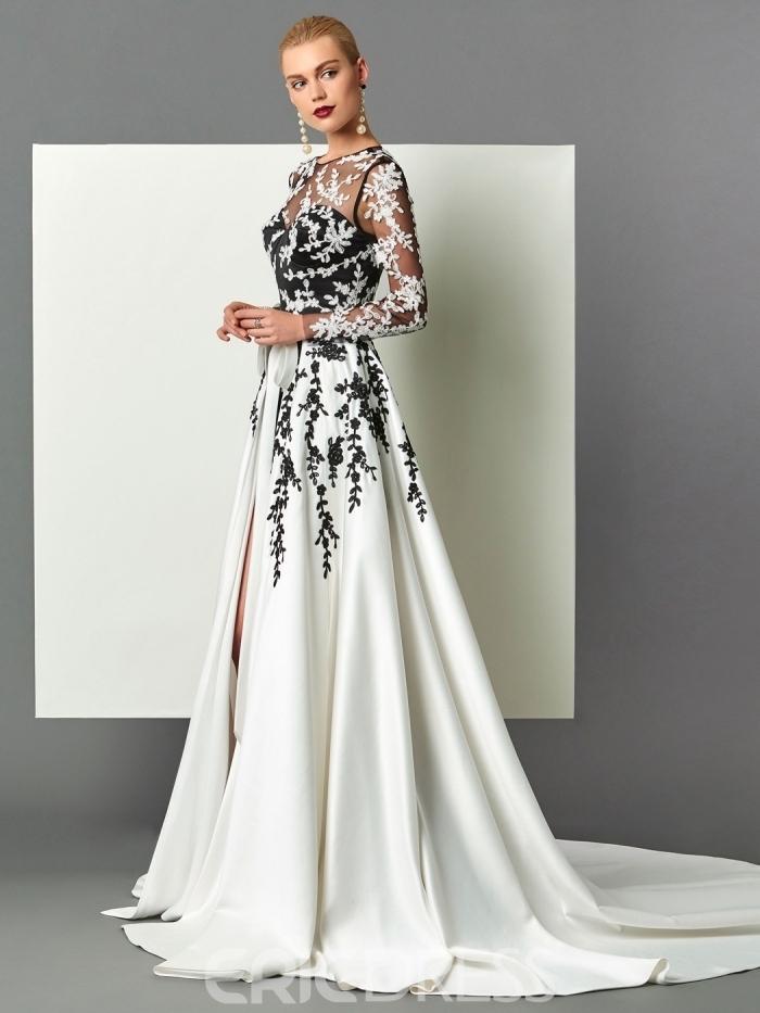longue robe de soirée pour mariage avec haut à bustier coeur noir et transparent aux manches longues et jupe blanche à volants