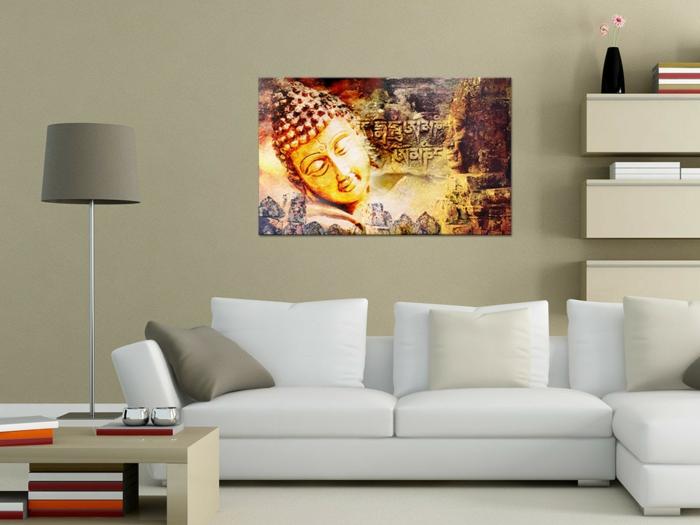 ambiance zen, décoration feng shui, panneau mural avec tête de Bouddha, table basse en couleur ivoire, meubles suspendus de rangement muraux en gris