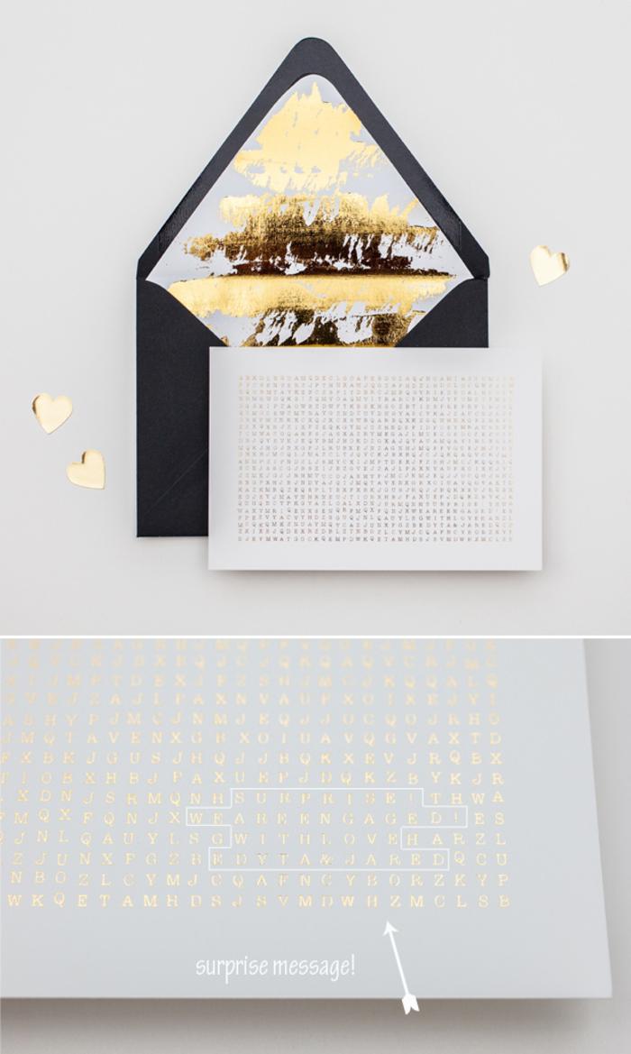 faire part mariage originale sous forme de mots mêlés accompagné d'une enveloppe noire à intérieur métallique doré