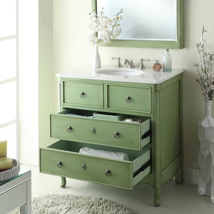 une commode salle de bain relookée avec de la peinture verte et transformée en meuble sous vasque fonctionnelle et esthétique