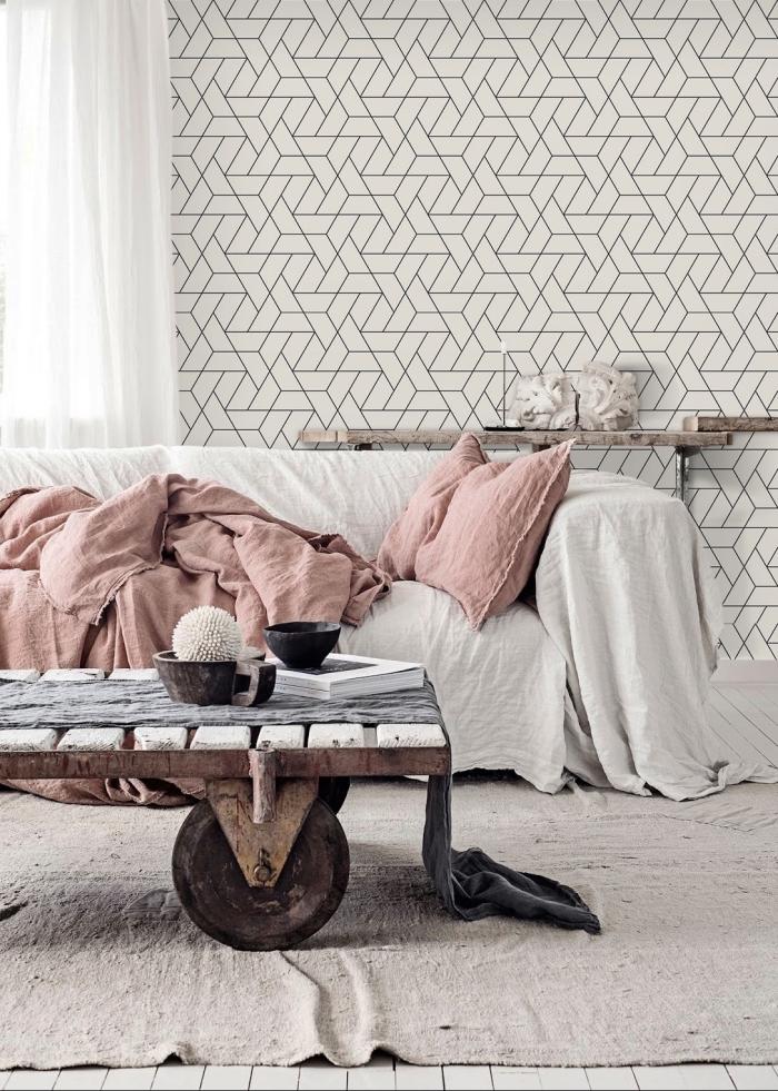 déco de salon blanc avec papier peint noir et blanc, intérieur de style rustique avec table basse en bois et tapis beige