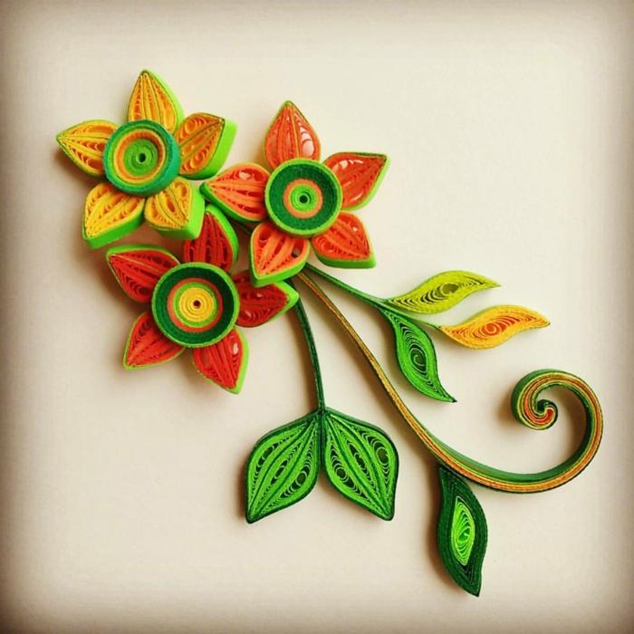 pliage papier original, fleurs en orange et vert, design artistique en couleurs joyeuses