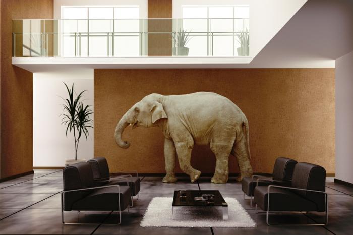 deco zen, deco salon zen, feng shui salon, éléphant sur le fond d'un mur ochre, palme verte dans un grand pot blanc, quatre fauteuils en simili cuir noir avec des éléments en métal