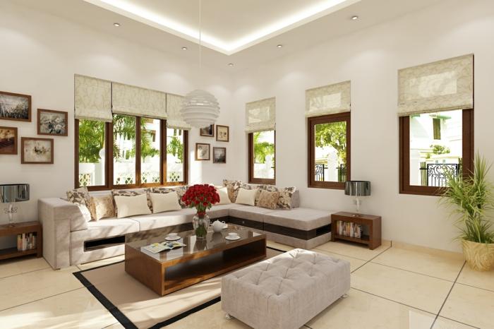 décoration feng shui, carrelage en couleur ivoire, murs en blanc, fenêtres avec des cadres marrons, canapé angulaire en blanc, tableaux avec des cadres en marron, vase en cristal avec des roses rouges