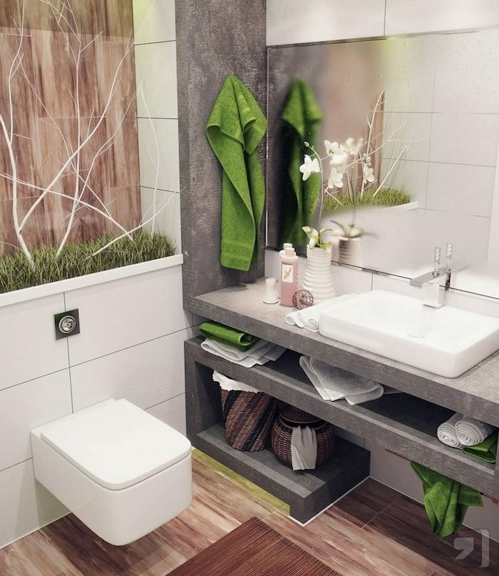 agencement salle de bain nature petite surface avec un meuble en béton, vasque blanche, grand miroir et installation nature