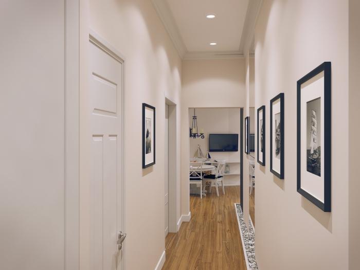 décoration du couloir blanc au plafond avec éclairage led et parquet de bois, mur de cadres photos noirs