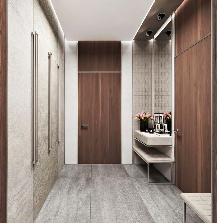 comment associer les couleurs dans l'aménagement du couloir moderne aux portes et garde-robe de bois foncé avec murs et plancher gris clair