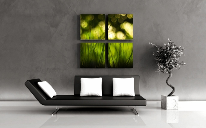 deco epuree, ambiance zen, canapé noir avec des coussins blancs, plante zen en pot carré blanc, panneau mural en vert en quatre parties, carrelage blanc, mur gris