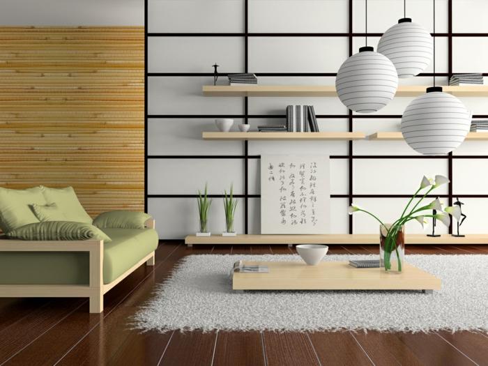 espace en marron, vert réséda et beige, trois luminaires boules en carton blanc en style chinois, salon feng shui, étagères en bois clair, tapis blanc, canapé en tissu réséda