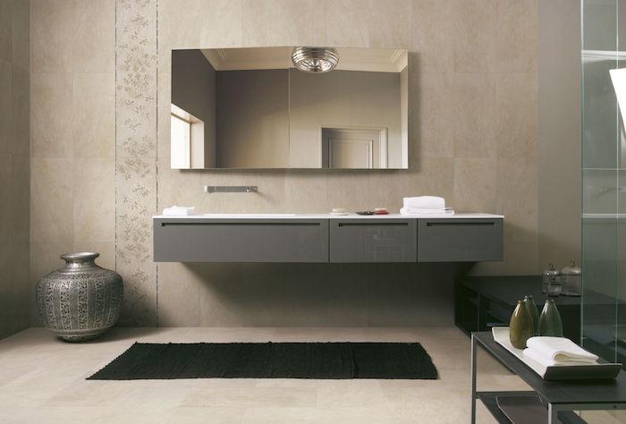 salle de bain beige et gris beige sur le mur et le sol, meuble salle de bain suspendu gris design