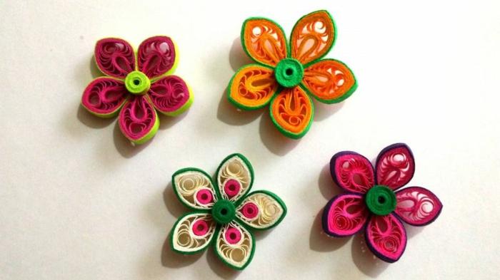 comment créer des fleurs quilling avec papier, pétales multicolores