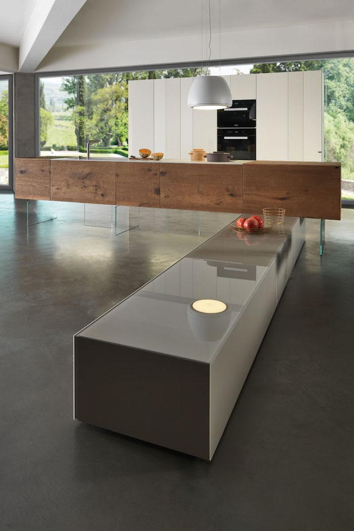 cuisine spacieuse design et moderne, modèle grand ilot en bas, sol gris laqué finition béton pour cuisines