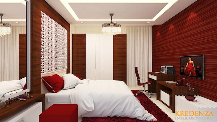 deco pour chambre adultes rouge et blanche, studio pour couple avec lit blanc bureaux et murs rouges