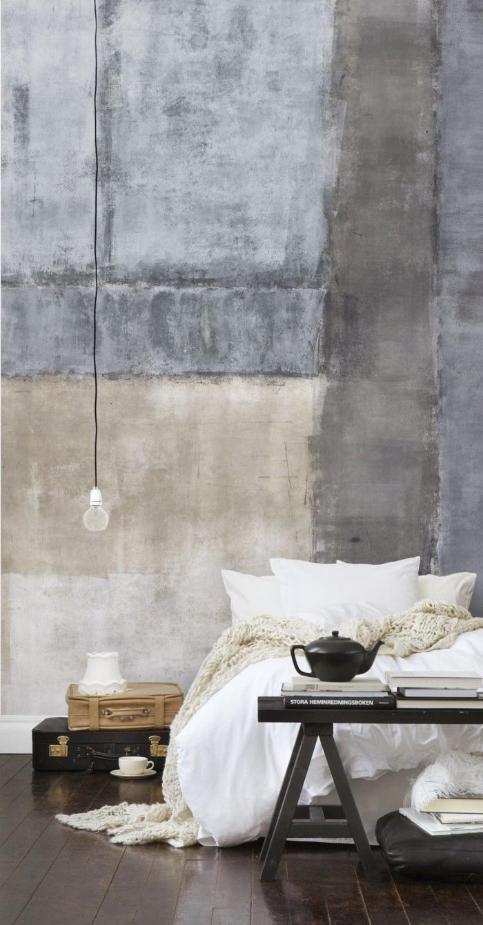 intérieur moderne dans une chambre à coucher aménagée en couleurs neutres avec un papier peint industriel à design béton