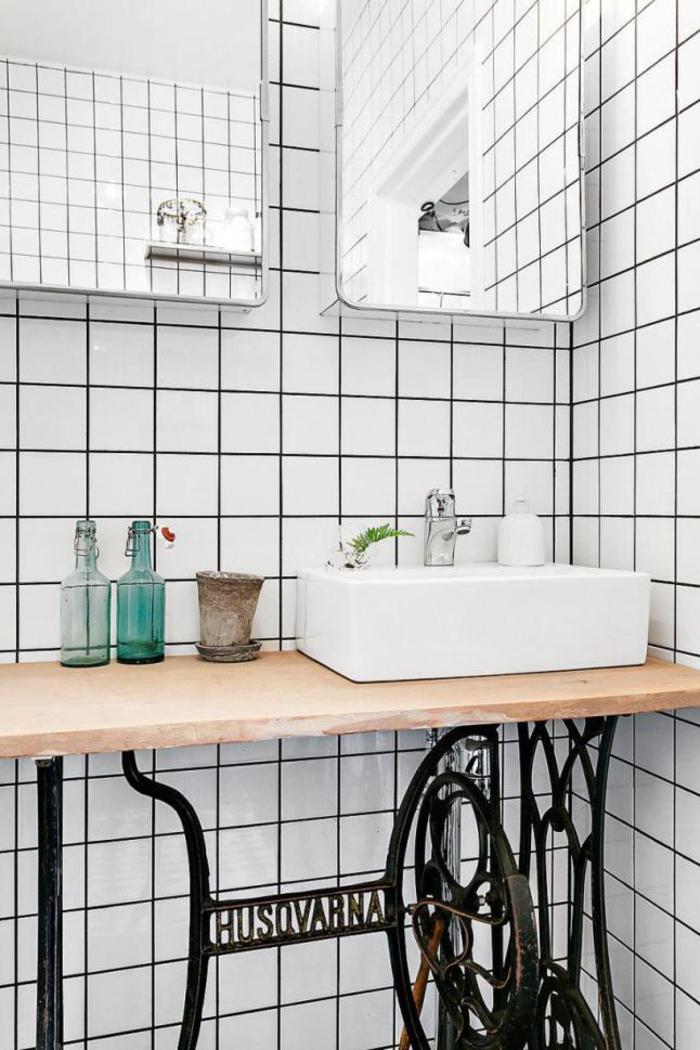un meuble vasque récup et un carrelage blanc tendance à joints noirspour une deco sdb chic et vintage