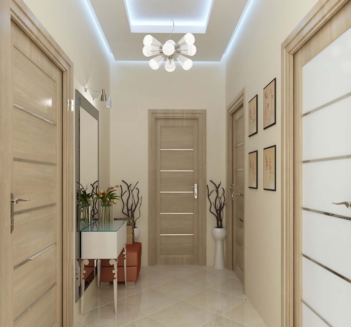 association de couleurs terrestres beige dans le couloir au plafond suspendu avec éclairage neon et au carrelage plancher beige