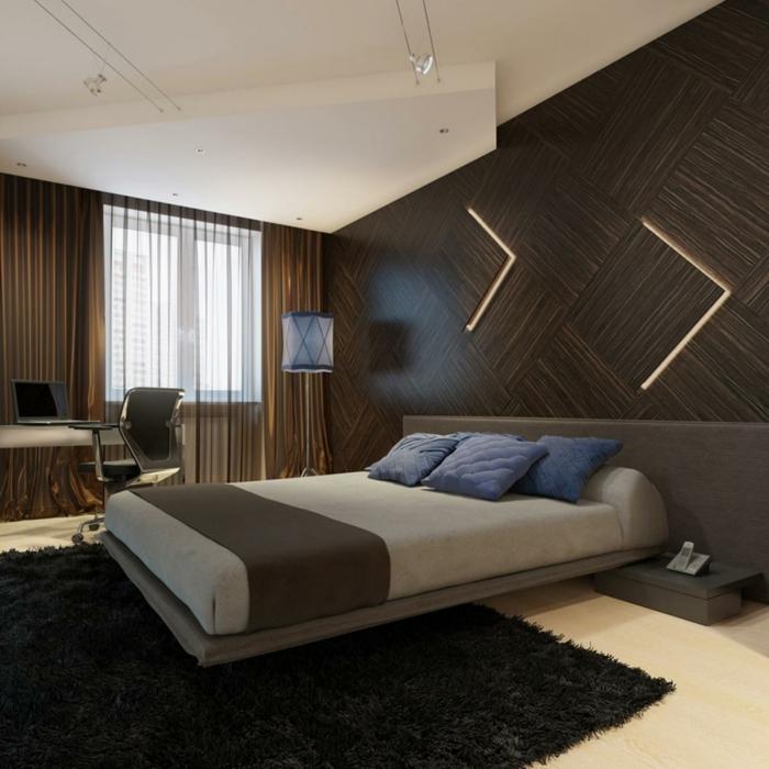 chambre zen, lit plateforme, tapis noir moelleux, éclairage mural original, coussins bleus
