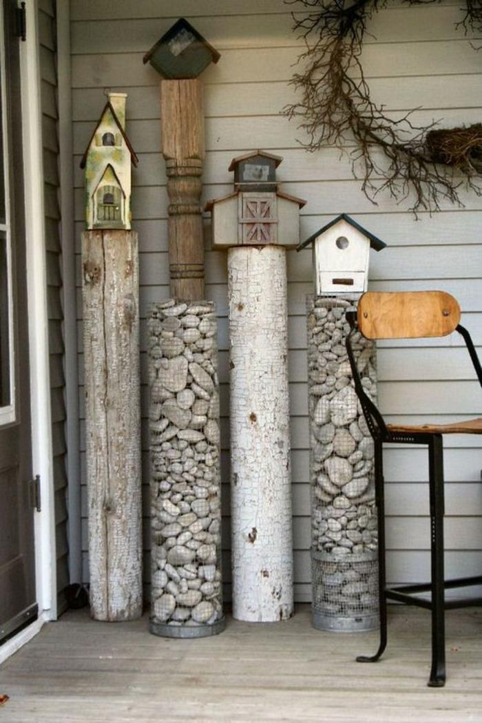 des colonnes décoratives en pierres blanches et grises, jardin paysager, déco jardin récup, decorer son jardin, amenagement jardin, entrée de maison
