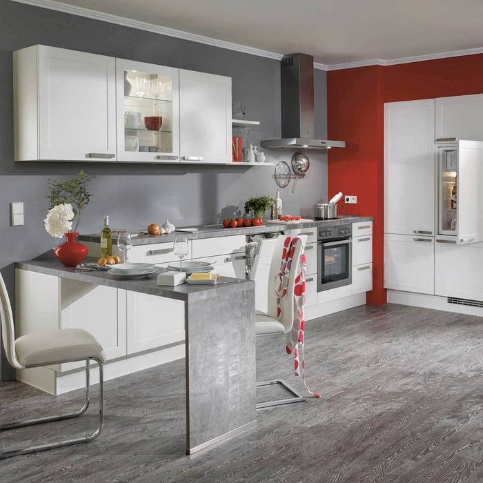 cuisine grise et rouge au design contemporain où le gris s invite sur les murs, le carrelage et coin repas intégré d aspect béton