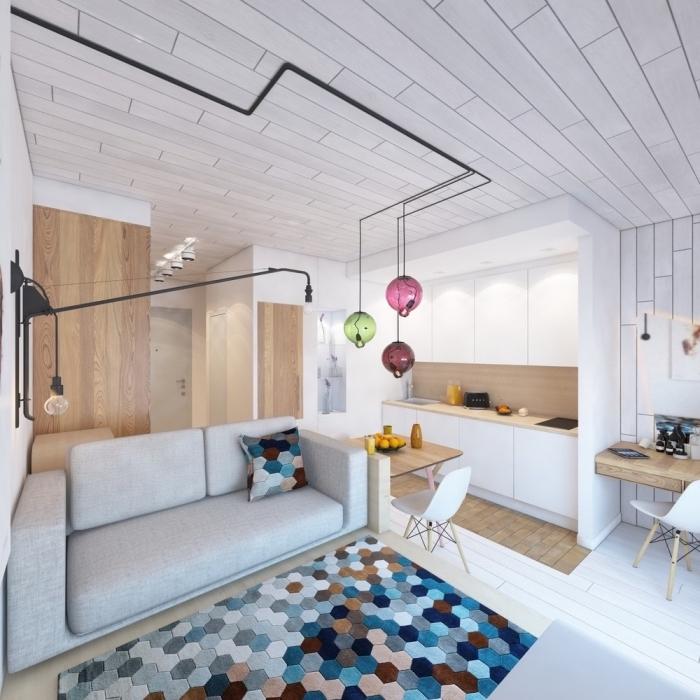 décoration appartement étudiant ultra moderne avec éclairage de style industriel aux tuyaux apparents et boules colorées