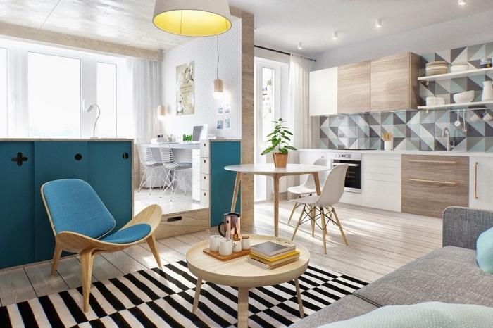 idée déco studio avec muret bleu et cube multifonction, petite cuisine aménagée en longueur avec meubles blanc et bois