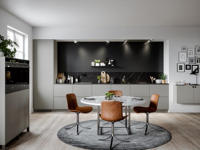 cuisine gris clair associée à un mur de crédence noir et marbre qui met en valeur l'élégance minimaliste de l'espace