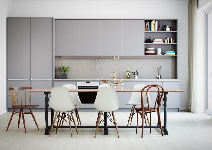 une cuisine gris clair minimaliste et discrète, aménagée en longueur et ouverte sur la salle à manger