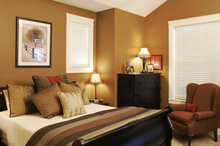 une petite chambre zen en couleur chaude, fauteuil marron, peinture encadrée originale