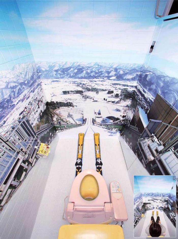 toilettes originales avec décoration murale paysage montagne en trompe l'oeil style ski