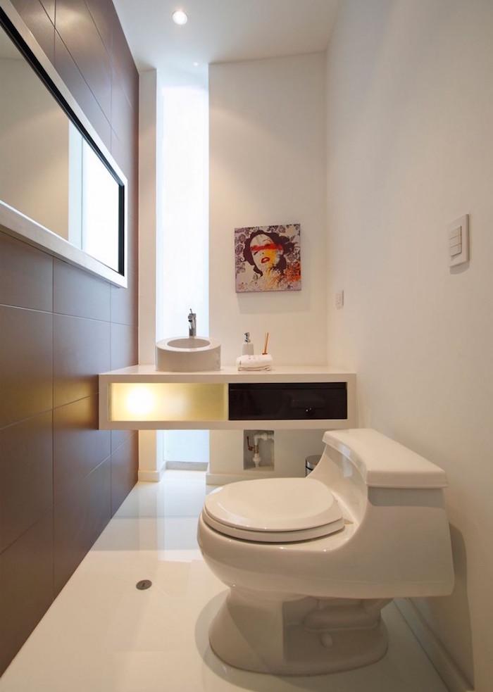 toilettes design moderne avec meuble lavago suspendu et déco blanche