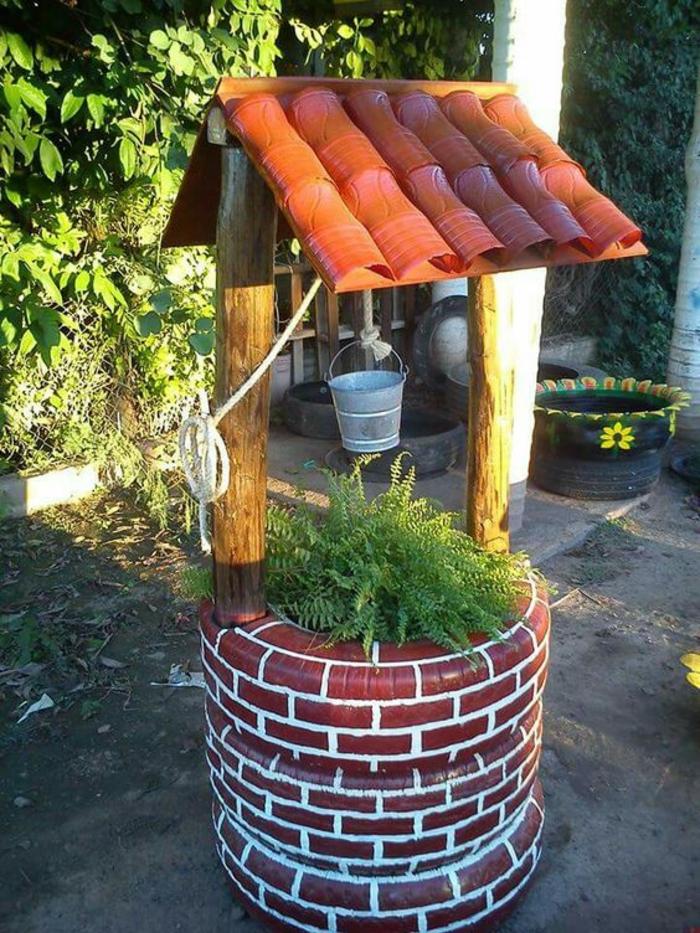 des pneus transformés en belle construction, decorer son jardin avec des objets récupérés, jardin deco, composition pour un jardin paysager