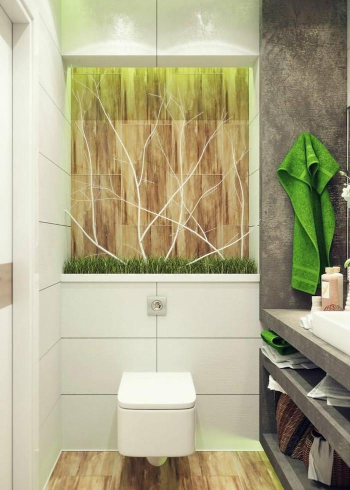 decorer ses toilettes style moderne blanc et gros béton avec déco art déco arbre