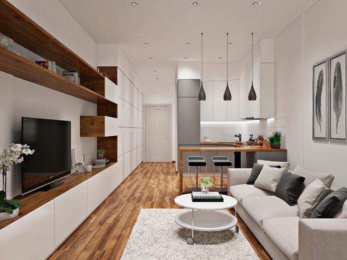 idée rangement fonctionnel dans un studio avec étagères de bois marron foncé, design épuré en blanc gris et bois