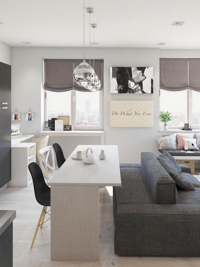 décoration appartement étudiant de style moderne aux murs blancs et mobilier en blanc et gris avec finitions métalliques
