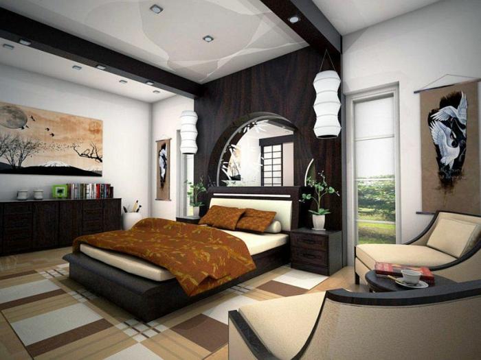 tapis en beige et blanc, plateforme lit noire, grands fauteuils cocoon beiges