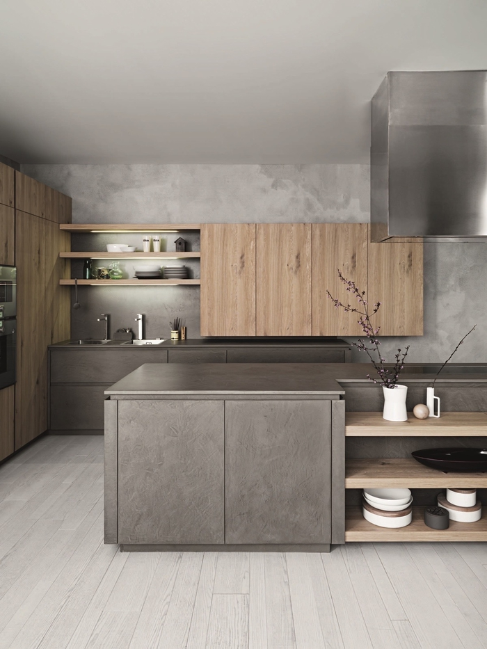 cuisine grise et bois qui joue sur les matières avec ses murs à effet béton et les meubles en bois clair
