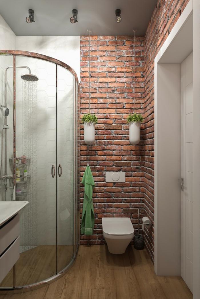 aménagement petite salle de bain et douche à l'italienne d'angle avec porte arrondie