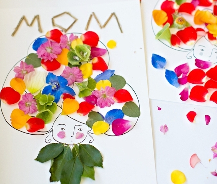 carte fête des mères maternelle avec silhouette de tête de femme aux cheveux fleuris colorés de pétales de fleurs