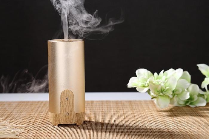 comment choisir un cadeau pour la fête des mères pratique, modèle de diffuseur de fraicheur et parfum à design bois et métal rose gold