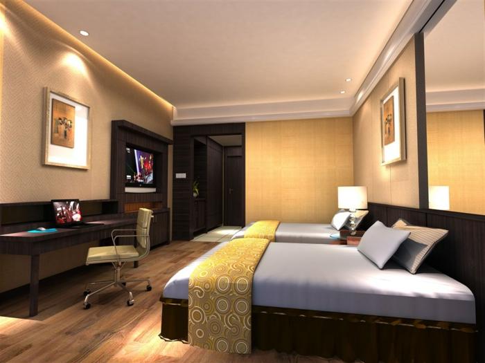 choisir l'orientation lit feng shui, parquet en bois, deux grands lits, peinture murale taupe, long bureau