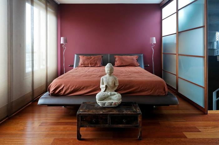 chambre à coucher style asiatique, statuette bouddha sur un meuble vintage, porte japonaise