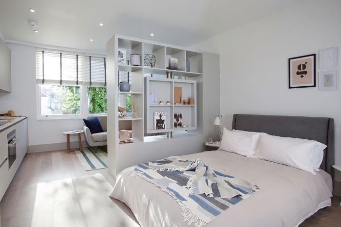 exemple aménagement petit appartement avec meuble séparation entre le salon et la chambre à coucher