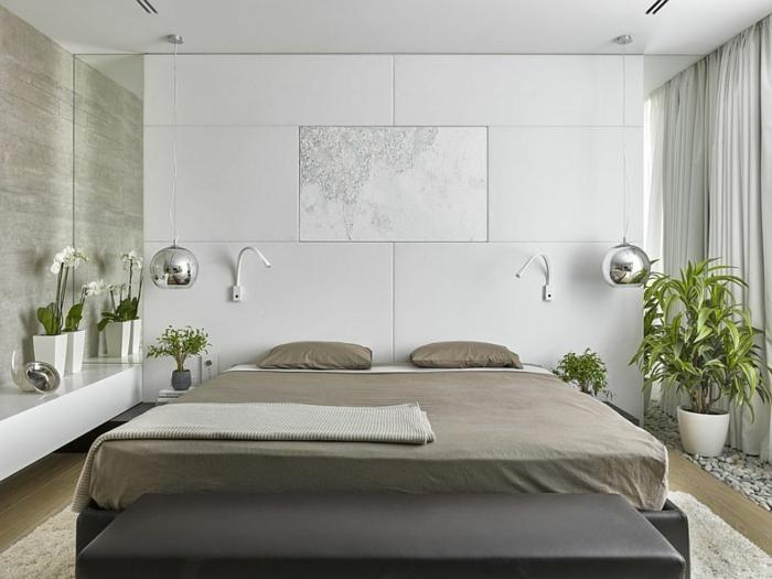 lit gris, tapis blanc, ambiance blanche et lampes pendantes chromées dans une chambre à coucher feng shui